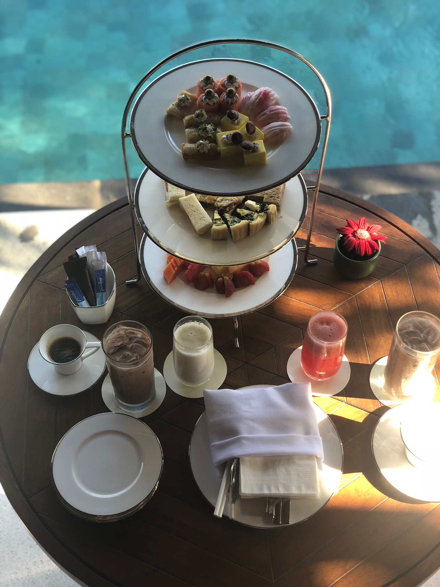 Afternoon tea served by our private pool at the  Bali Hilton
