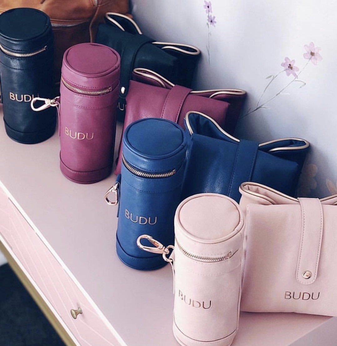 Budu Baby  The accessories set comes with a padded, wipe down change mat and insulated bottle holder in the most beautiful colours including blush, navy, plum, black and cream. Bonus: it is already packaged in a gift box so no need for wrapping! Great price point at only $69.95   Shop Now