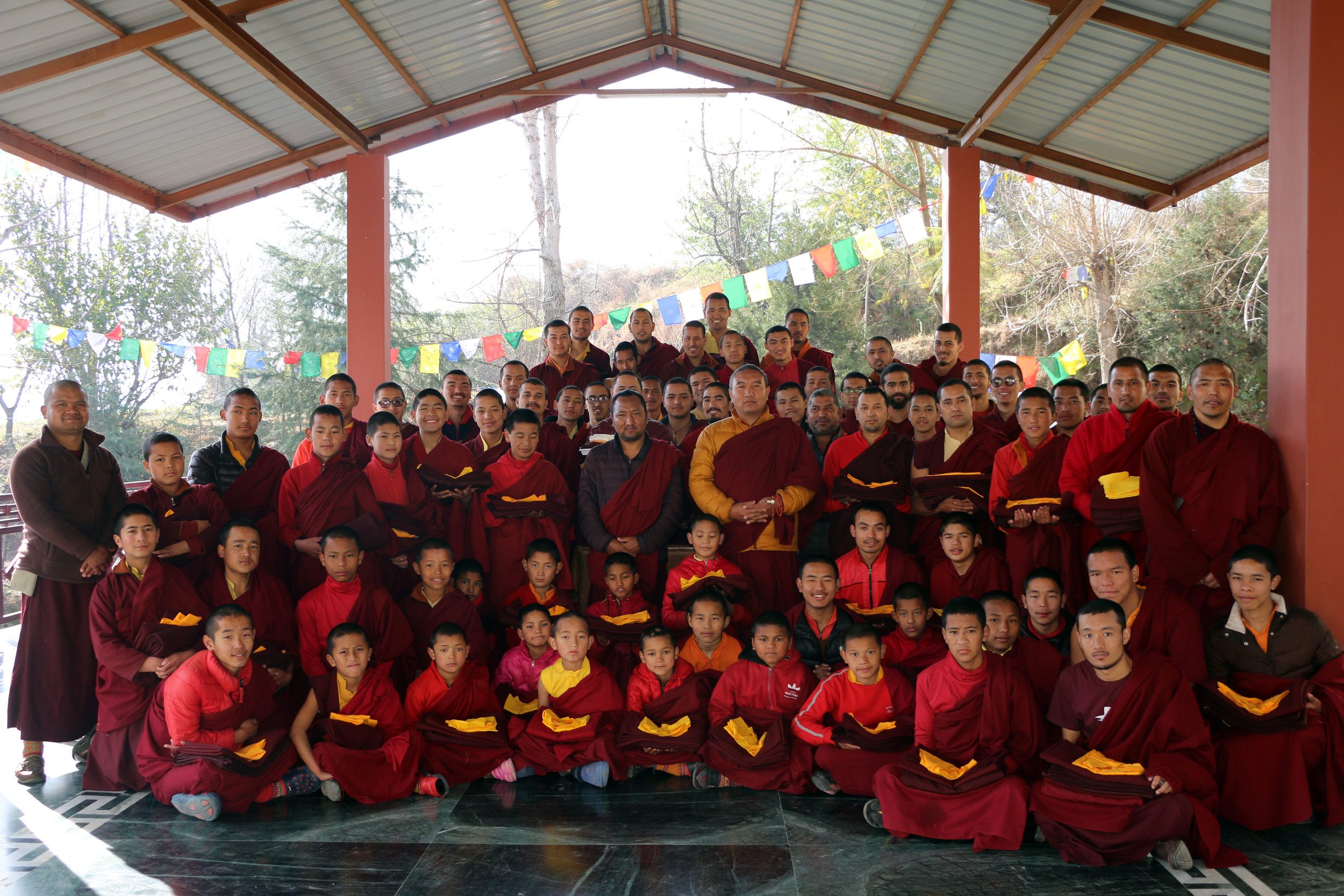 Dechen Choekhor monks posted together after receiving their yearly provision of new monk robes before Tibetan New Year.