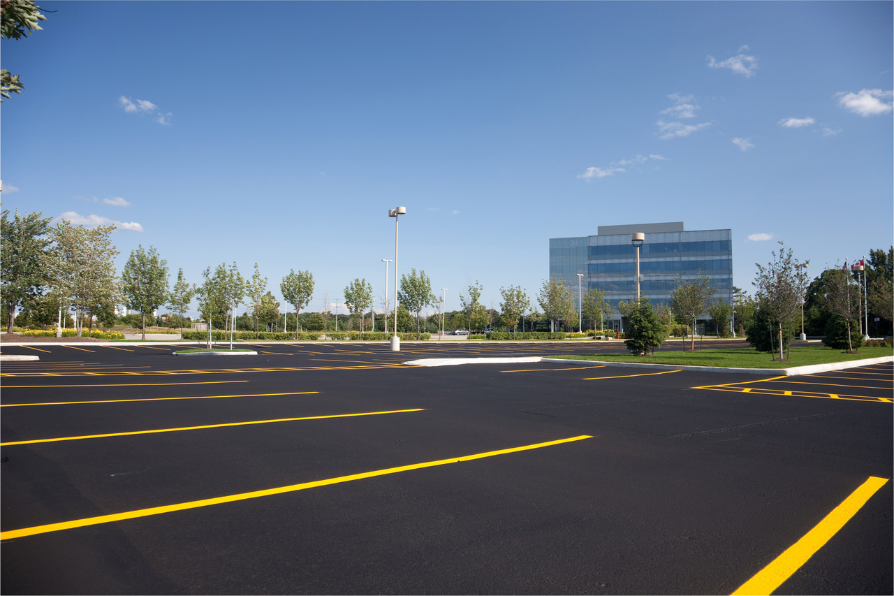 Sealcoating & Striping - We offer high quality asphalt sealcoating for parking lots, roads and residential driveways.