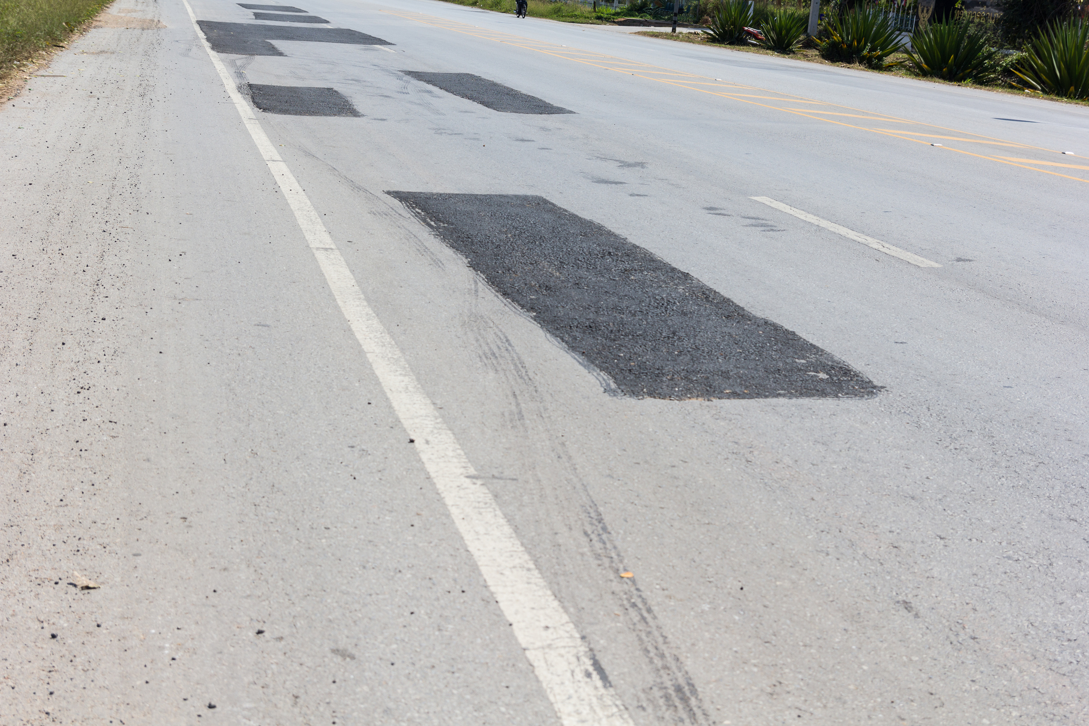 Asphalt Repair/Patching - Repairs done right the 1st time will all but eliminate problems in the future. Apex Asphalt offers complete removal, base excavation, fabric placement (if required) and full depth asphalt patching.