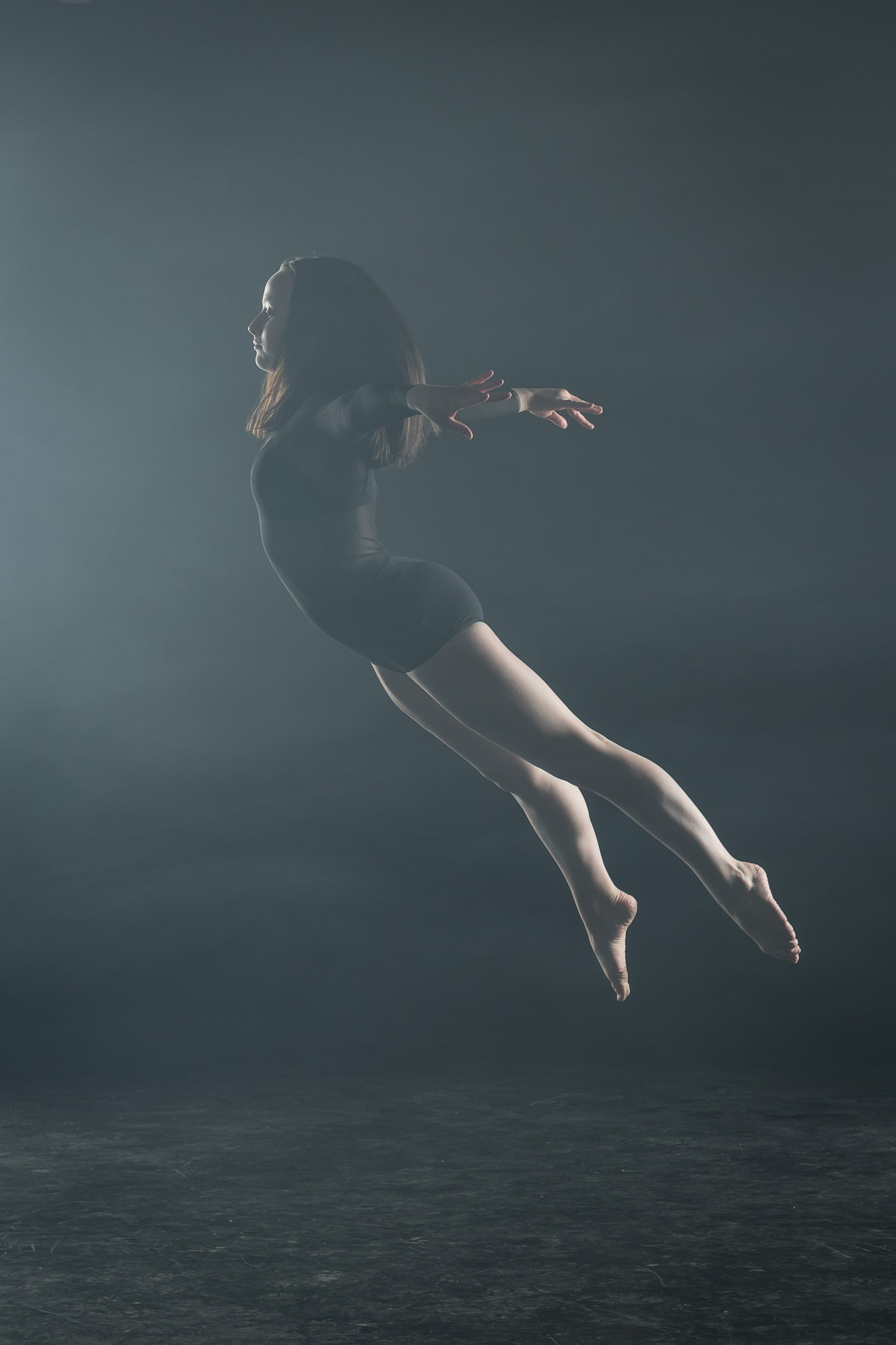 female-dancer-jumping-in-fog.jpg