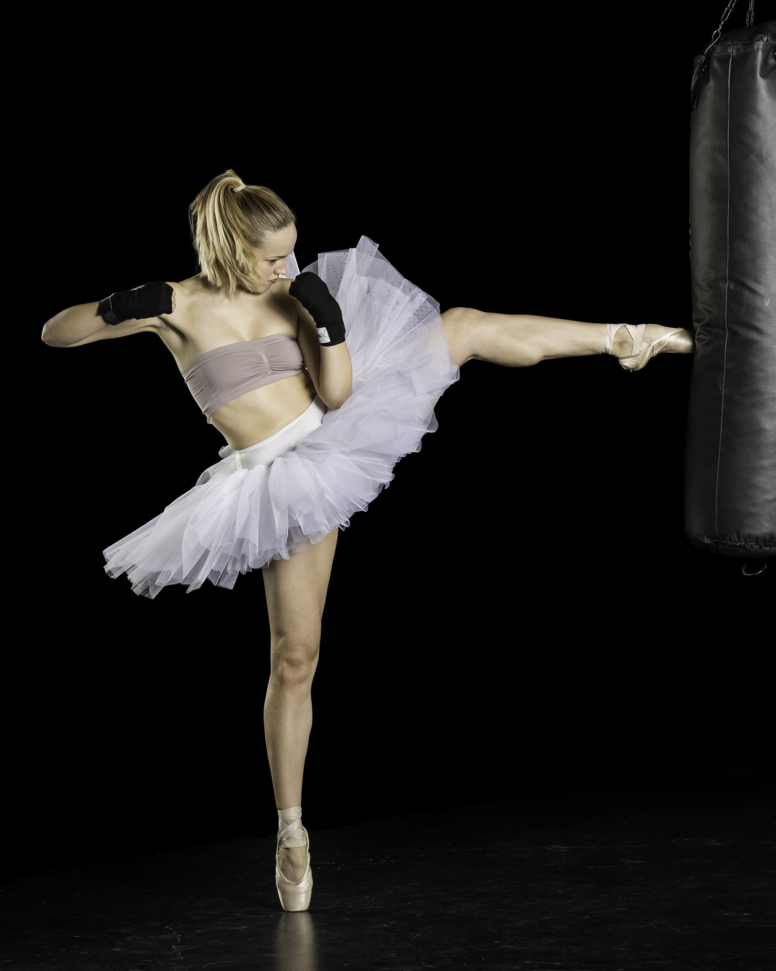 ballerina-in-tutu-kicking-heavy-bag.jpg