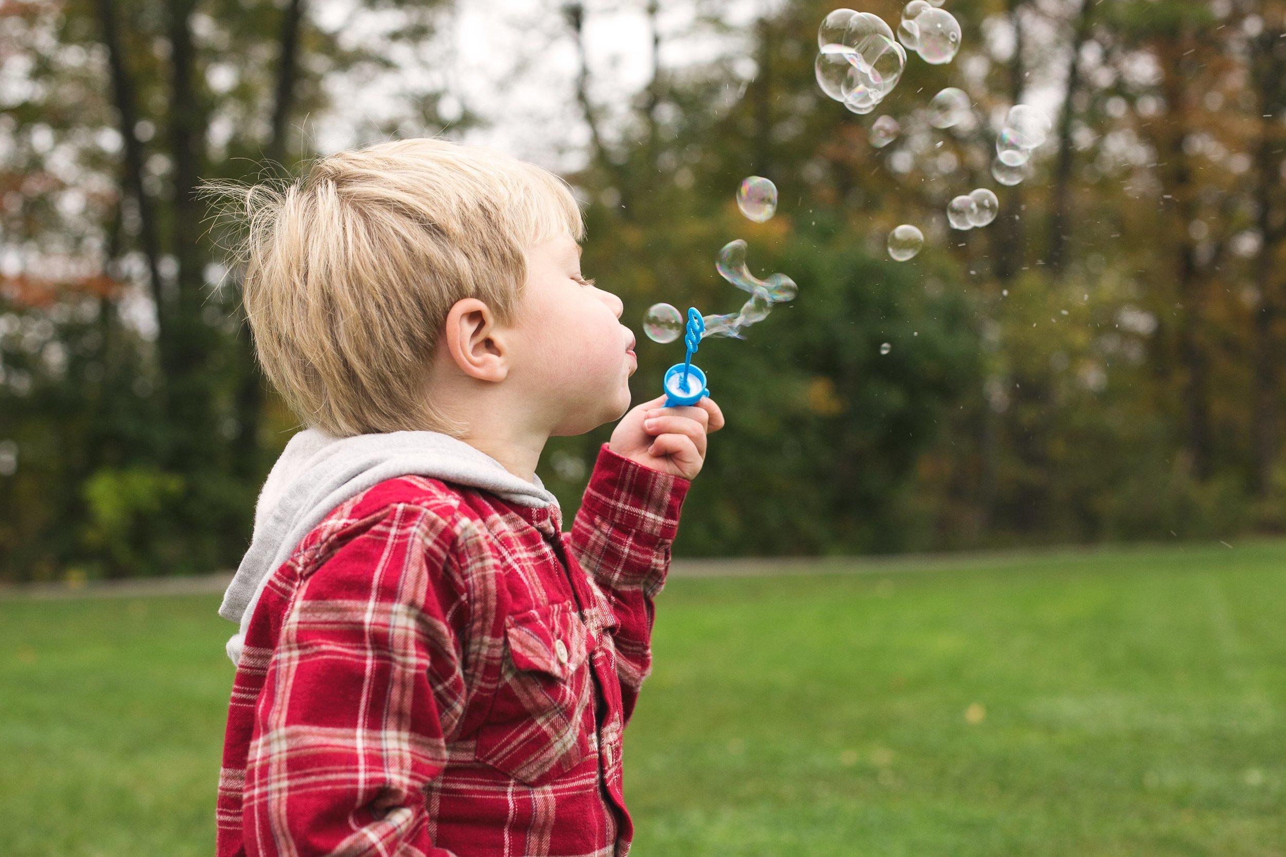 boy-blowing-bubbles_4460x4460.jpg