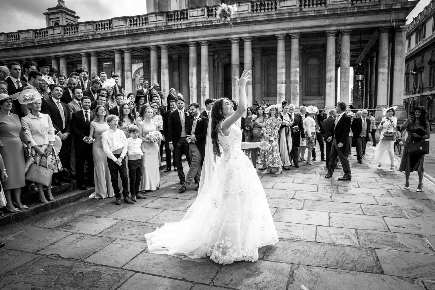 Littleton-Rose-Natural-History-Museum-London-Wedding-Planners-Throwing-The-Bouquet.jpg