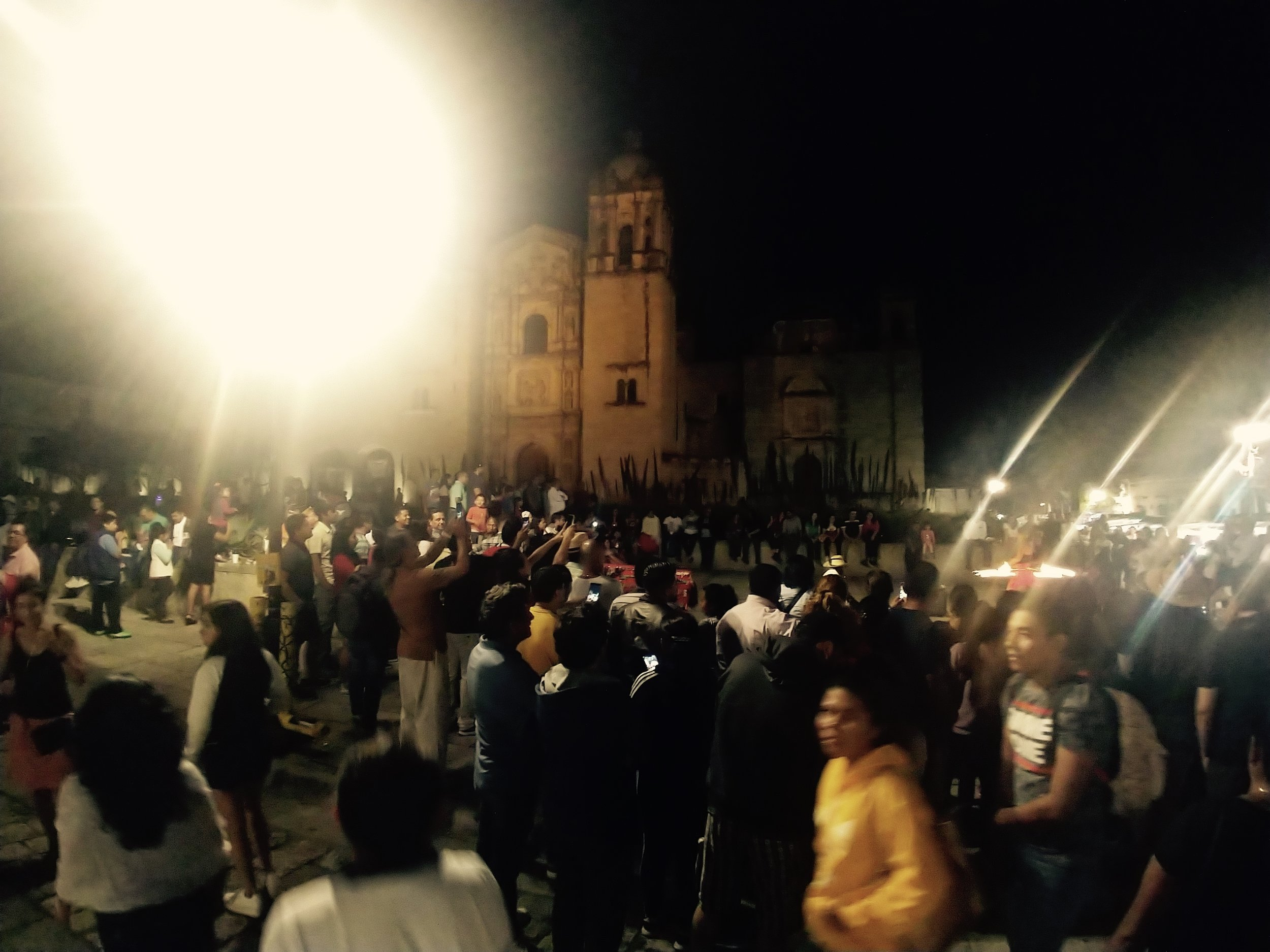 A square at night, filled with good looking people - Oaxaca, MX