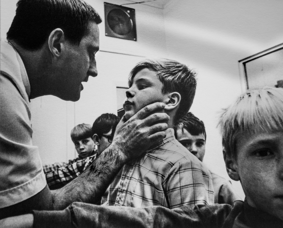 5. instructor pinches boy's face .jpg