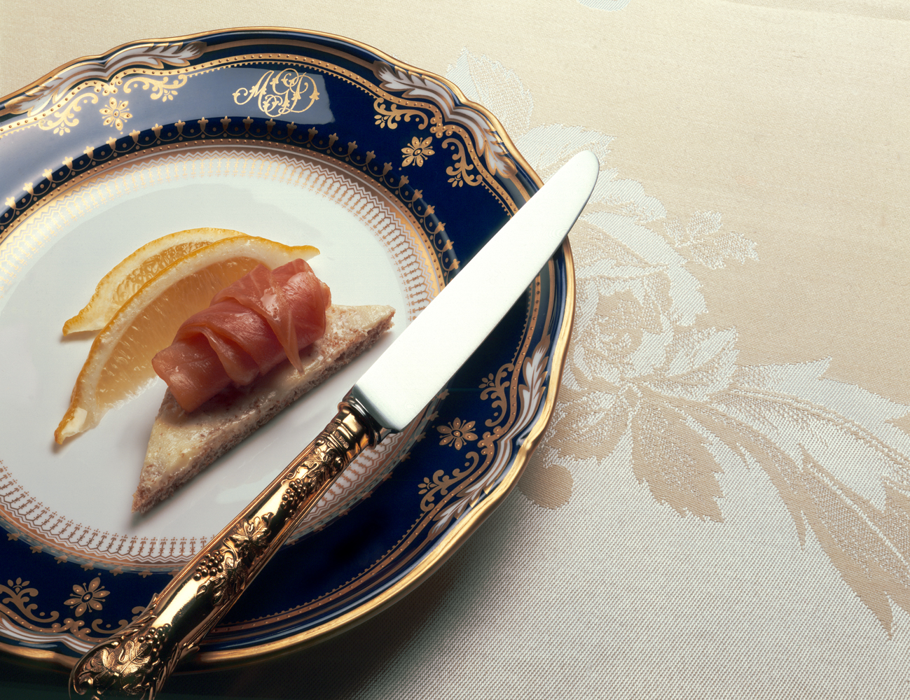 smoked salmon on brown bread (on gold rimmed plate).jpg