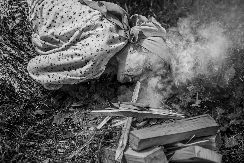 lady starting fire…mono .jpg