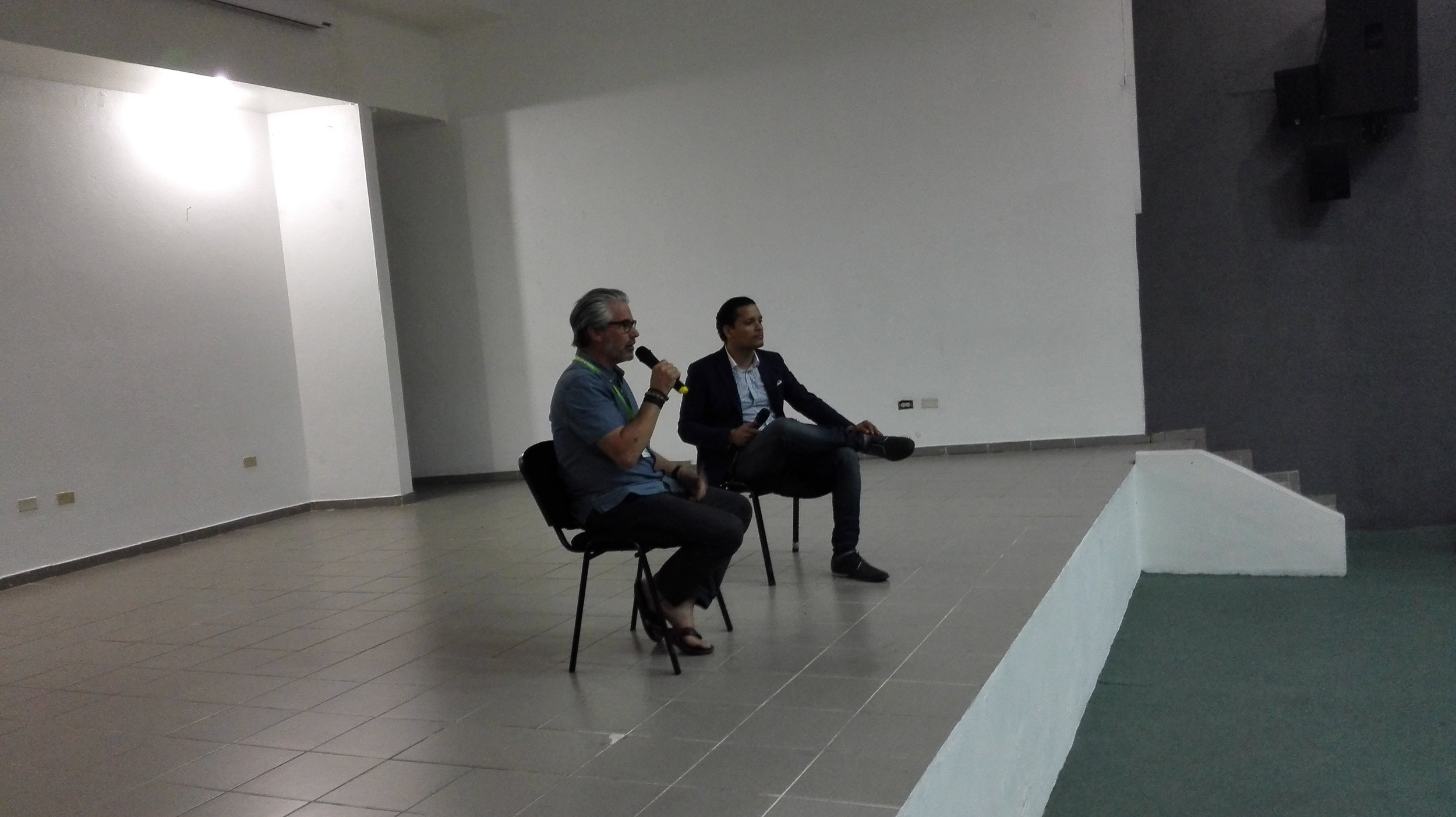 Paul Lazarus answers questions with moderator Edison Santos at Pontificia Universidad Catolica Madre Y Maestra (PUCMM) in the Dominican Republic.