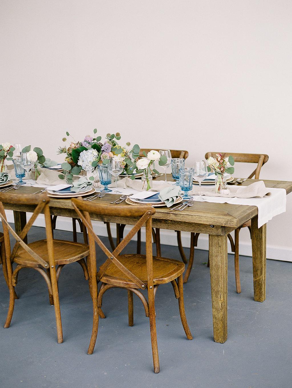 blue dining table seaside inspired design beach atmosphere dayton wedding planner