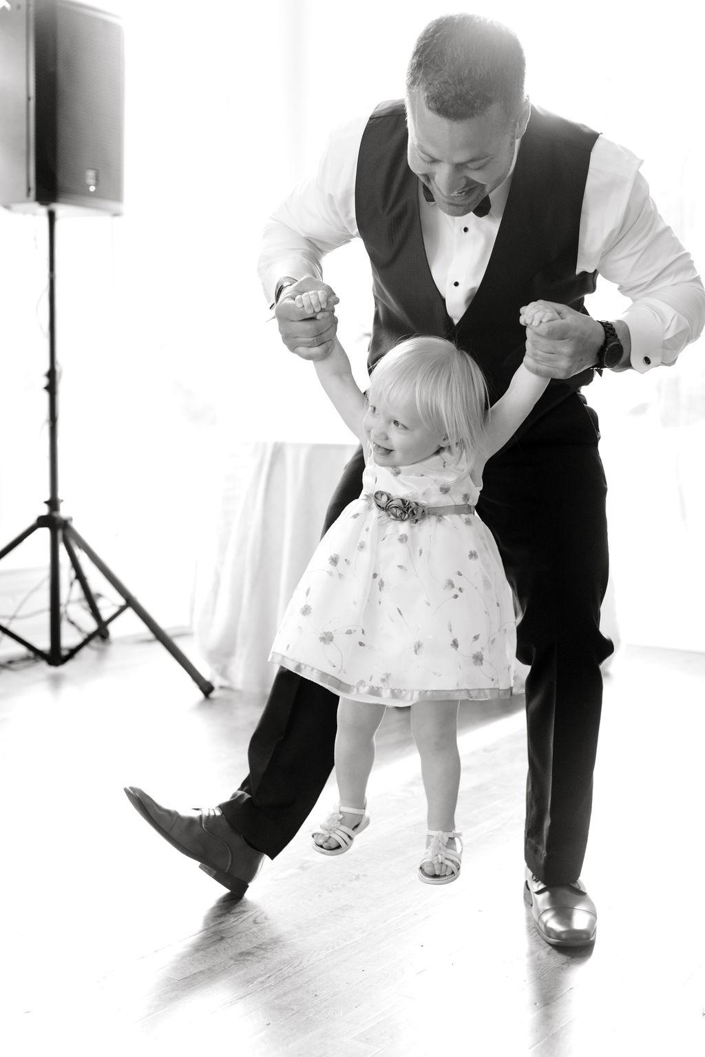Dayton-event-planner-wedding-groom-and-daughter-dancing-wedding