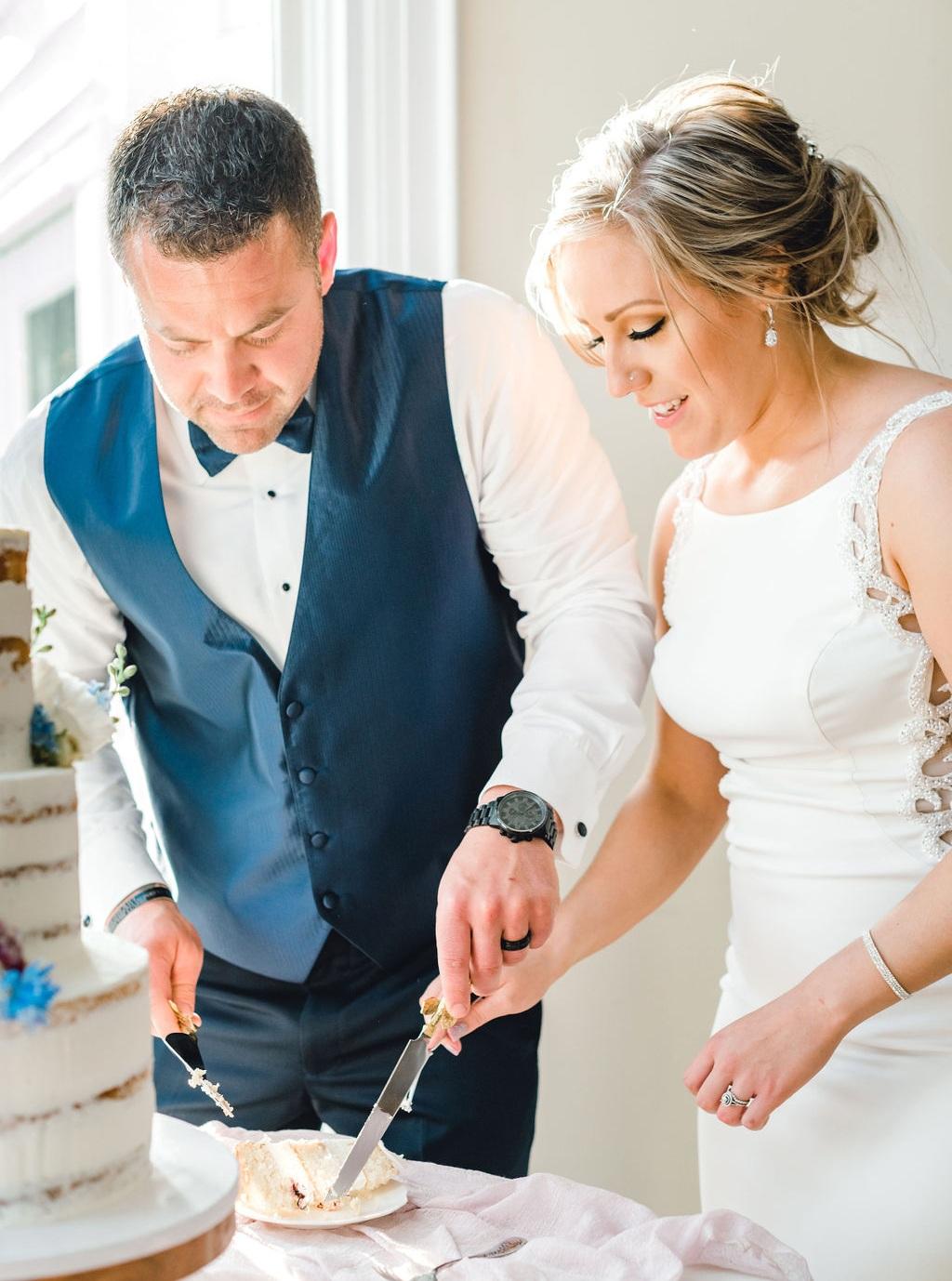 Dayton-event-planner-cutting-wedding-cake