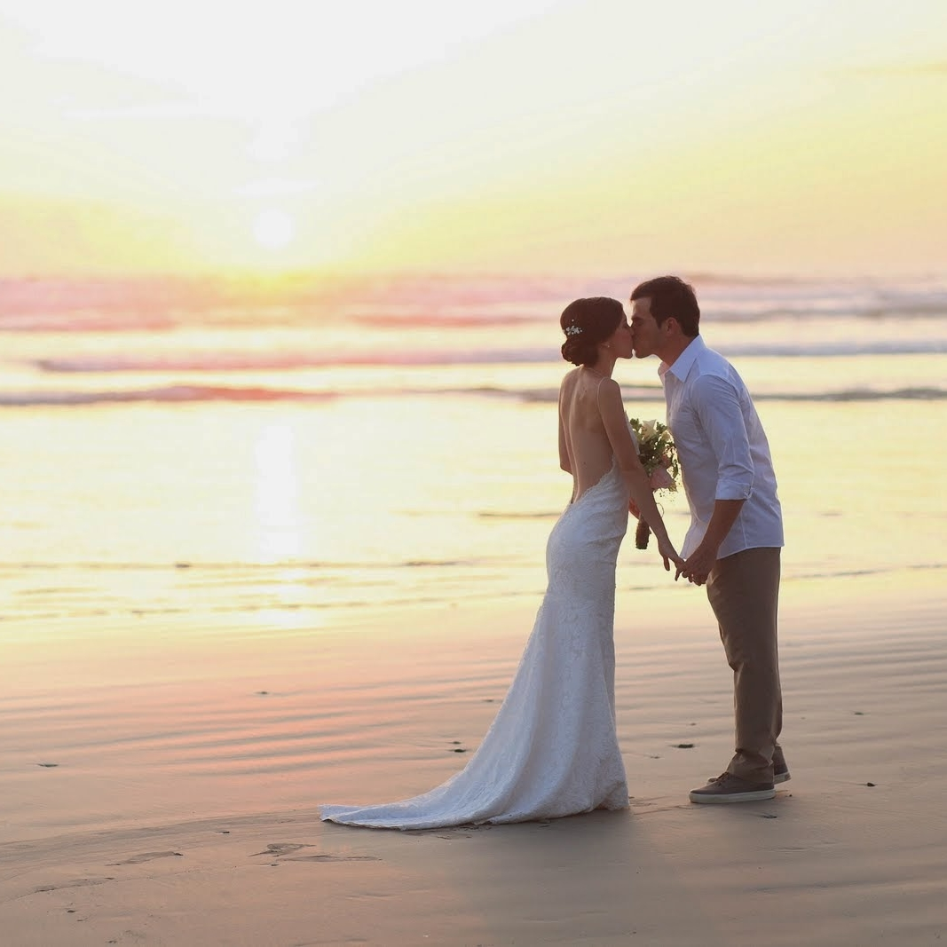 """Your Dream Costa Rica Beach Wedding - Say """"I do"""" during a brilliant golden sunset with the rolling waves crashing gently behind you. Your Costa Rica beach wedding begins in Santa Teresa with Simply Rustic. With over a decade exploring the most beautiful places in the area, we set up and manage your beach wedding and reception locations so you can focus on what matters most: your beloved."""