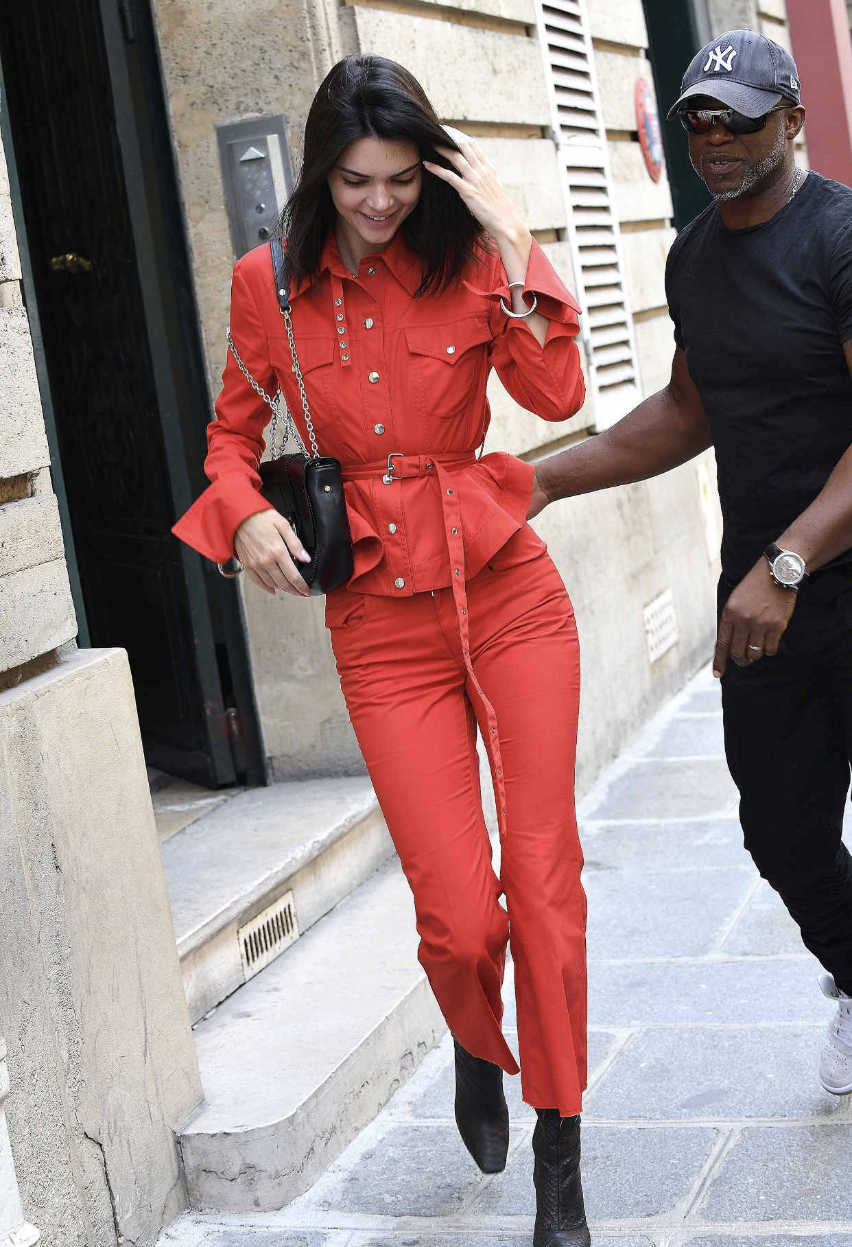 KENDALL ROCKS ATOREADOR SUIT - IF YOU THOUGHT YOU WAS STEPPING INTO SOMETHING SEXY WELL GET THIS, KENDALL JENNER HAS WOWED US AGAIN. IN PARIS TO SEE THE MAN HIMSELF ALEXANDER WANG. KENDALL WAS WEARING UK-BASED DESIGN MARQUES' ALMEIDA' TAKES ON STYLE WITH AMAZING COLOR, TEXTILE, AND ITS CREATIVE EDGE. THE FIERY ELEGANT RED JACKET AND TROUSER, PAIRED WITH A MATCHING SKINNY BELT, TIGHTLY CINCHED GIVING THIS JENNER AN HOUR GLASS FIGURE. LONG CHAMP POCKETBOOK, WITH BLACK PYTHON YEEZY BOOTS.📸:splashnews.com
