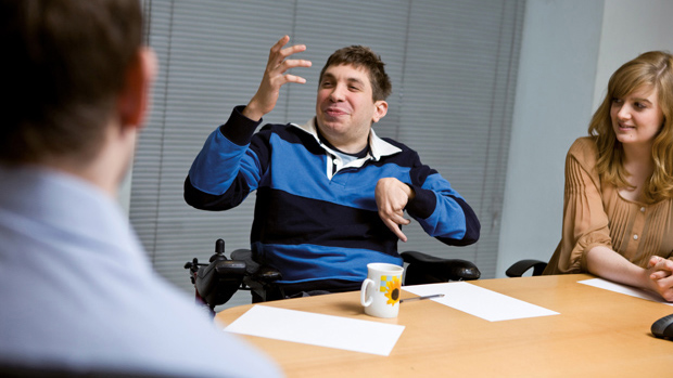Disabled-man-talking-in-meeting.jpg