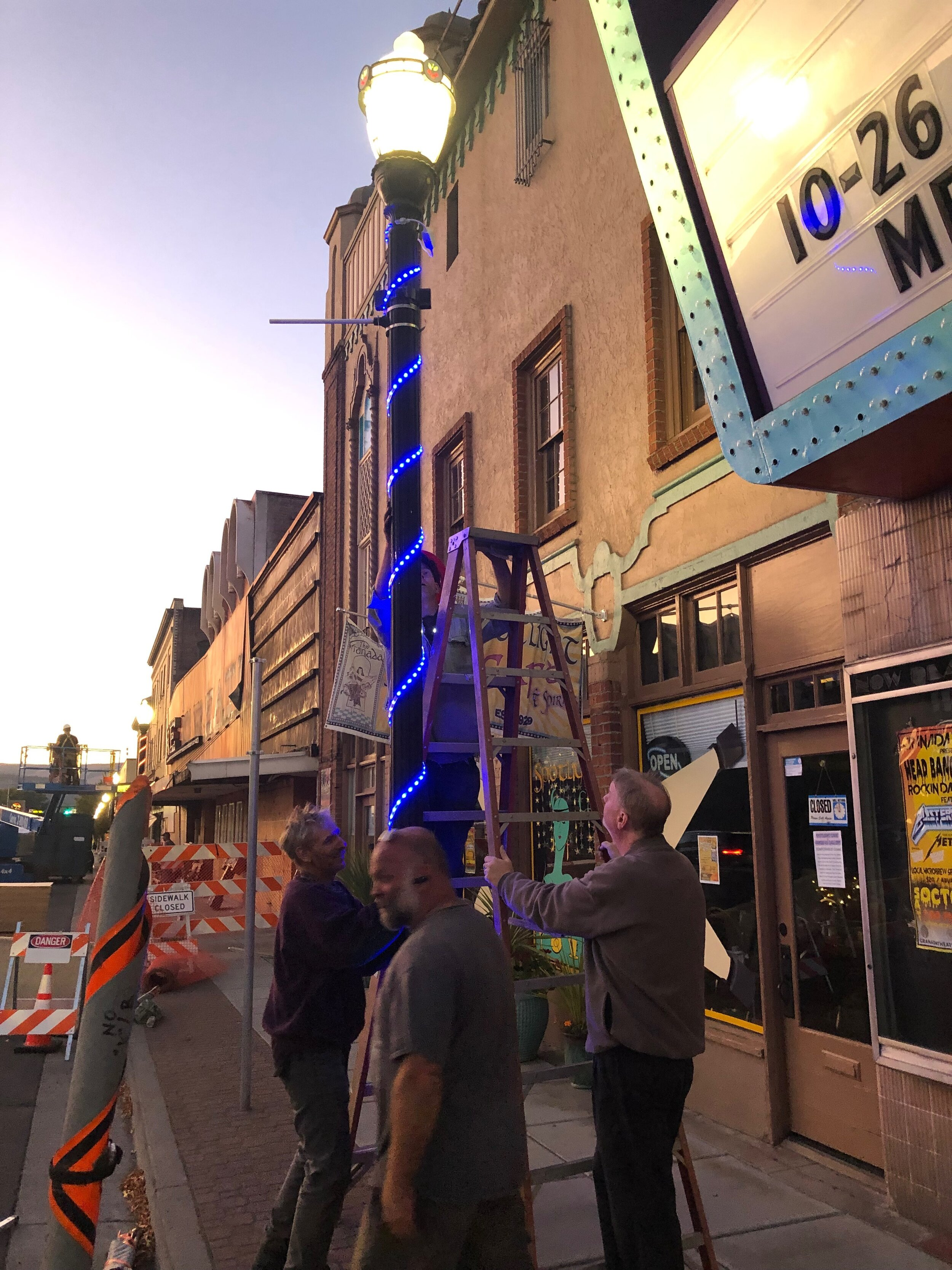 - Board member Todd Carpenter putting up our new lights downtown