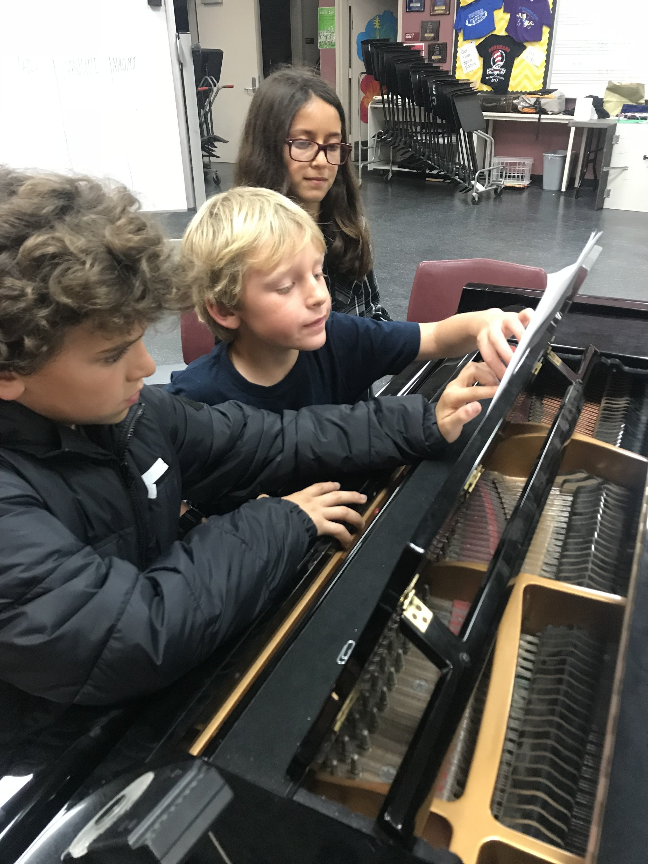 Examining a score together at a Music Workshop