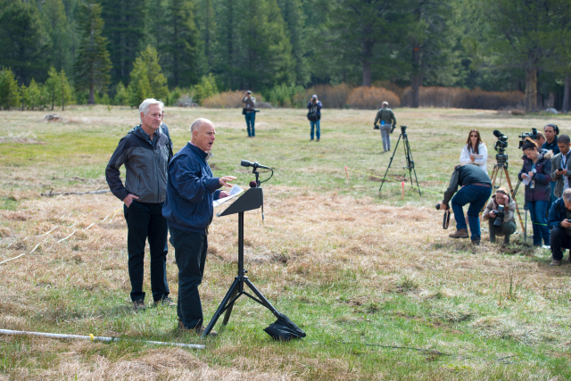 Gov. Jerry Brown addresses the media at a snowless snow survey site just south of Lake Tahoe on April 1, 2015. Photo by Florence Low/DWR.