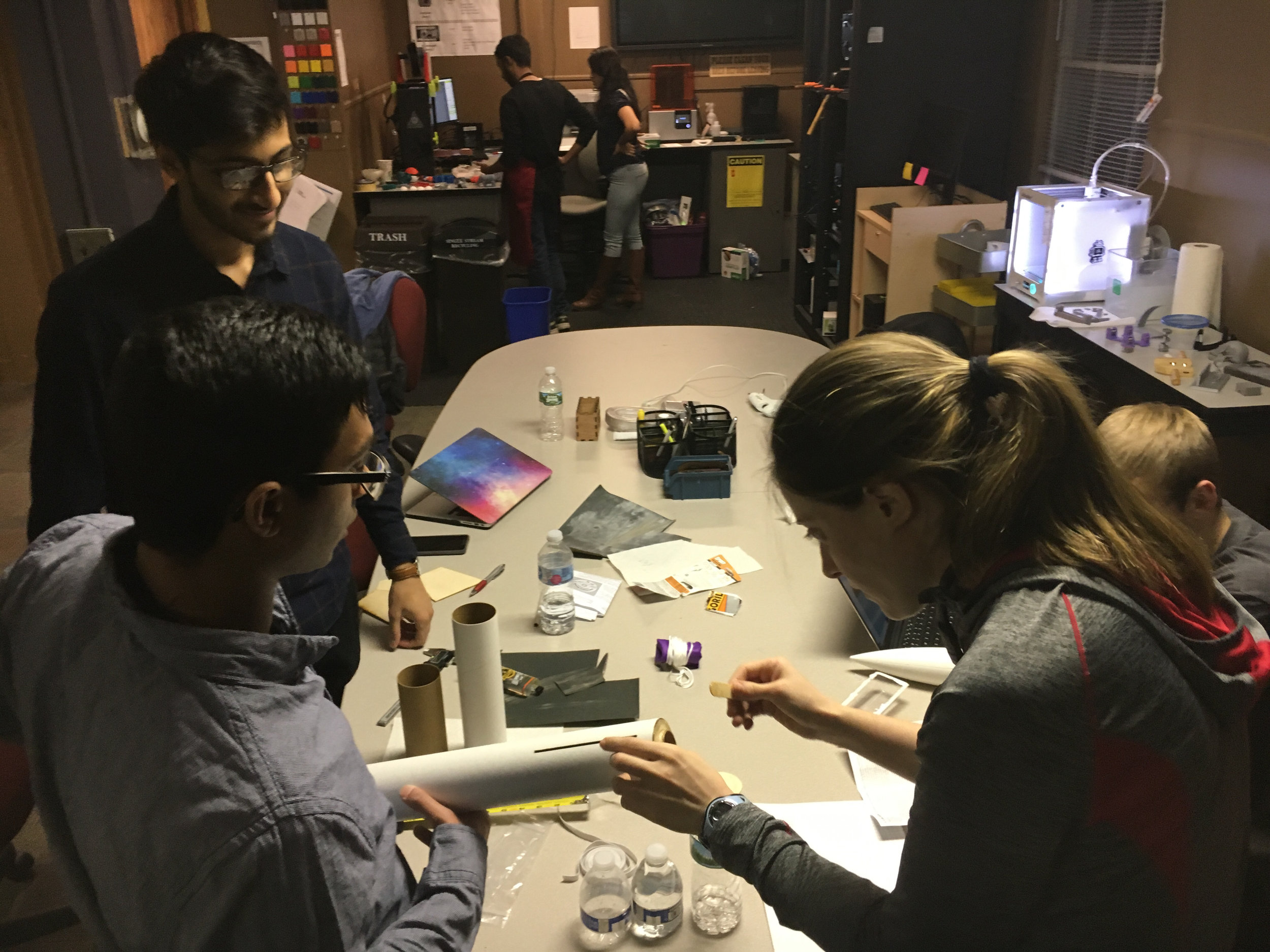 - Here's (Left to Right) Parth, Partth and Elyse working on a Level One Certification rocket.