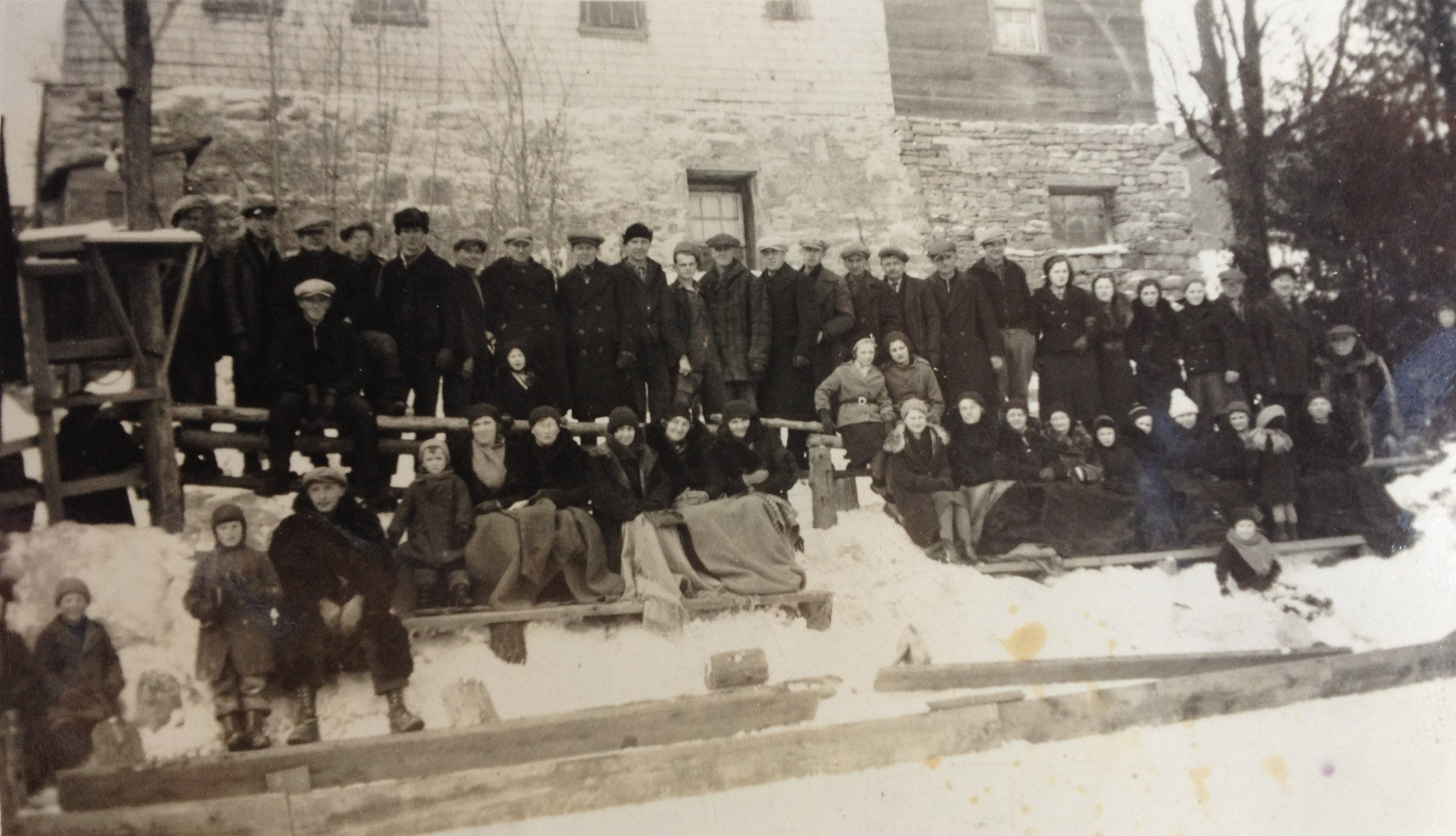 Village residents at a Horning's Mills hockey game on Marshall's Pond in the 1930s, in front of what is now the Wild Mill Studios