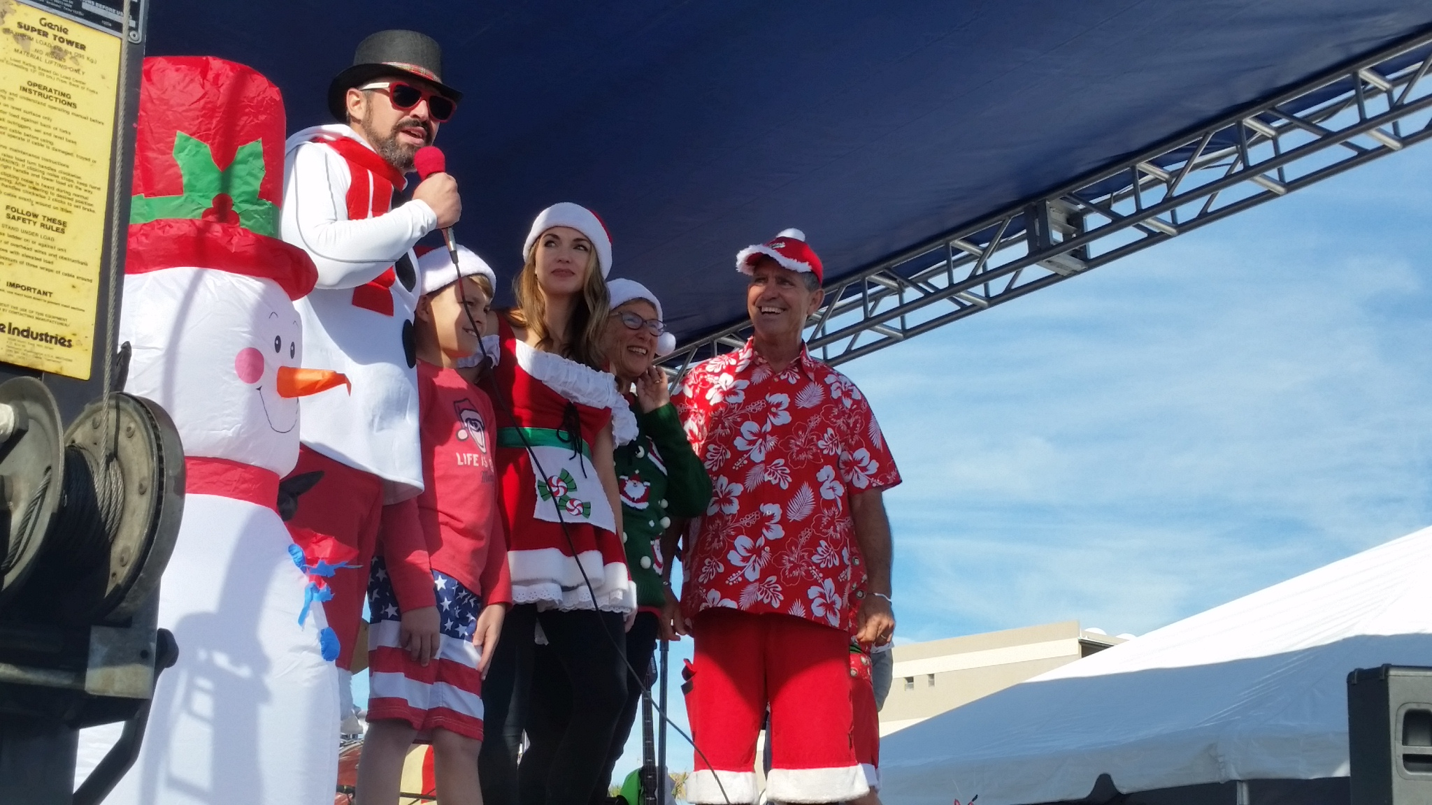 George Trosset (far right) and his family sending the Santas to start surfing