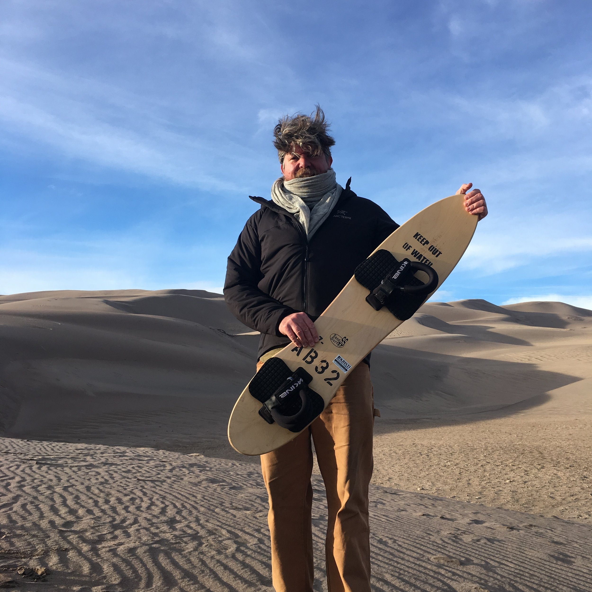 The author (Ted) posing with a sandboard