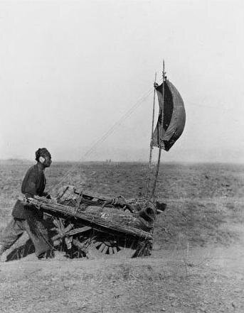 Dude with a wind powered land ship!