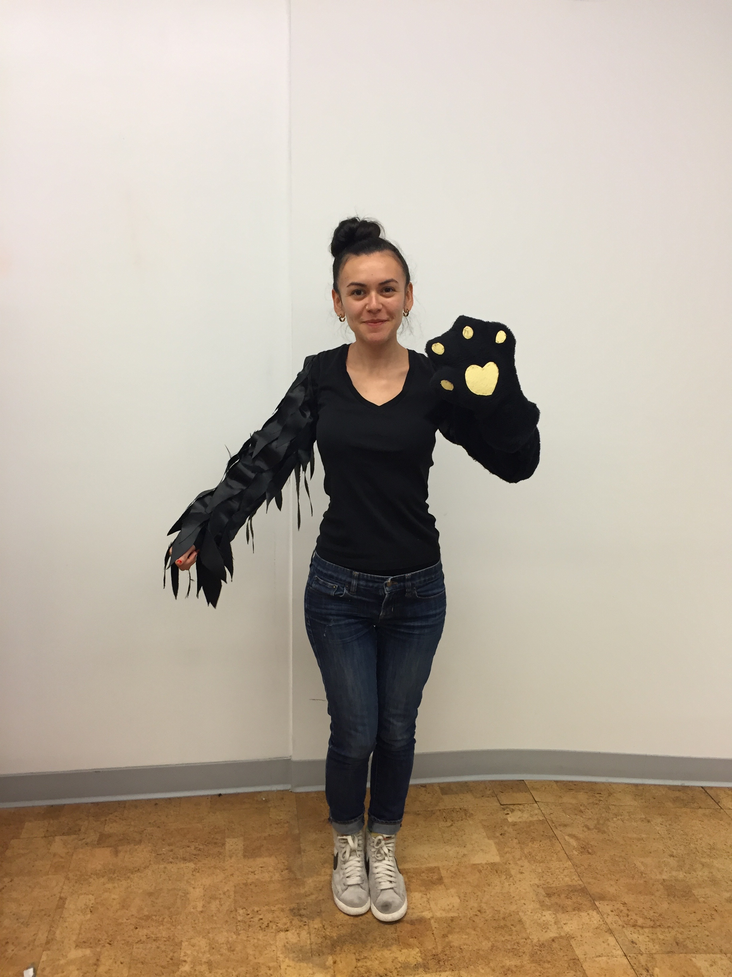 Created this costume to play the video game Graveyard Escape  -- scratch with the cat claw and flap with the raven arm to navigate the game.