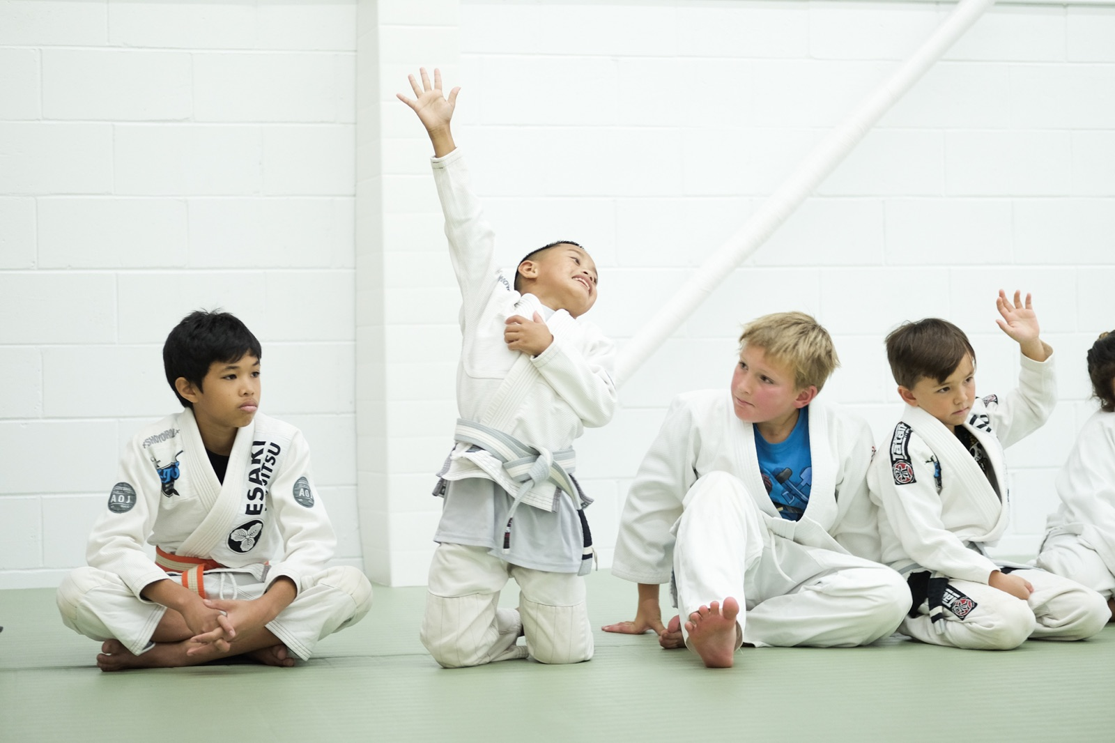 Kids - Our kids program is for kids and teens of all levels. Whether your child is looking to just have fun in an after school hobby, get some exercise, or wants to prepare for entering jiujitsu competitions, we have training for everyone. We teach kids how to work well with each other, the value of discipline and good physical training, all while providing a fun and safe environment.Learn more ➝