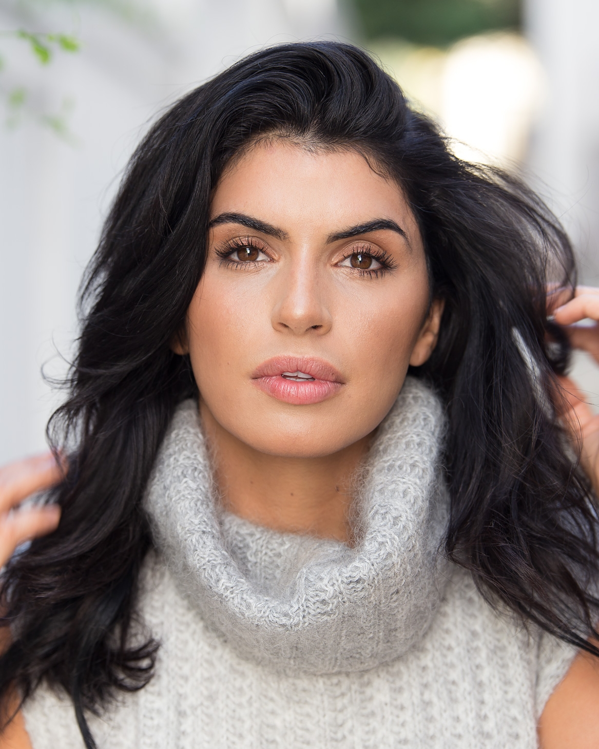 Beautiful, brunette model headshot, brown eyes and white grey sweater, photographed in El Segundo near Los Angeles, CA.