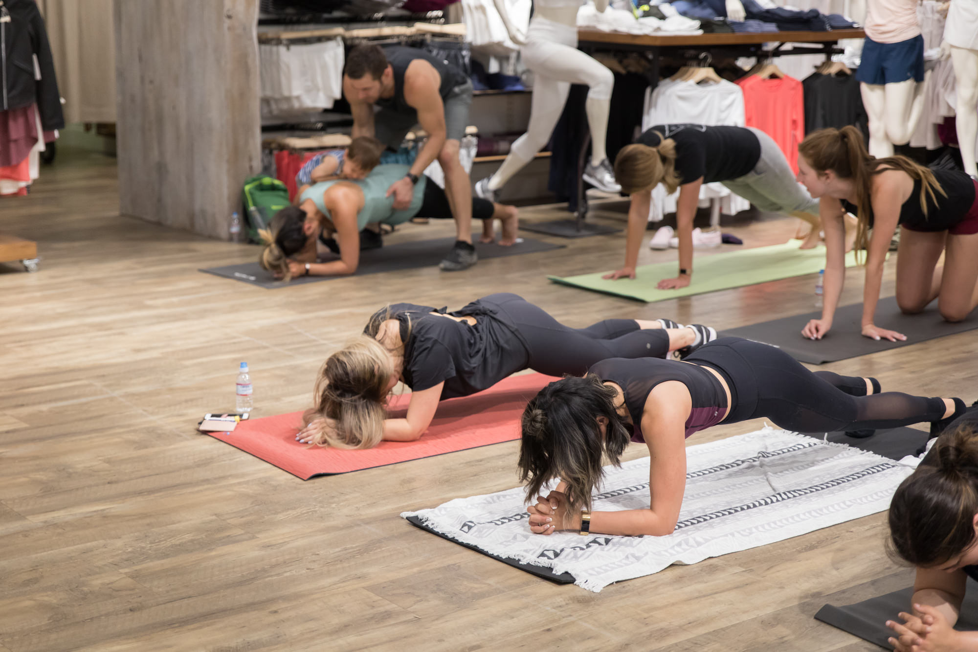 people-in-plank-hold-group-fitness-workout-athleta-store-san-jose.jpg