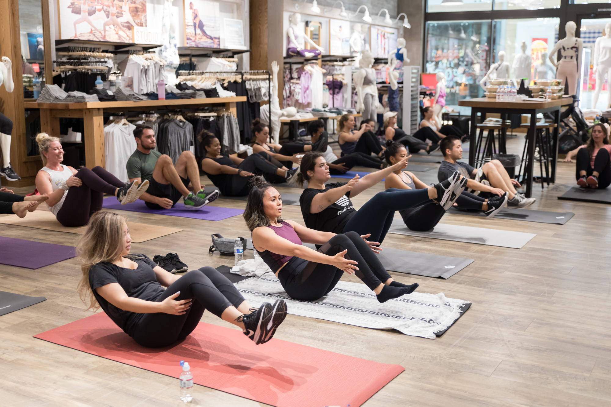 group-performing-situps-ab-exercises-group-fitness-pegactive-workshop-athleta-san-jose.jpg
