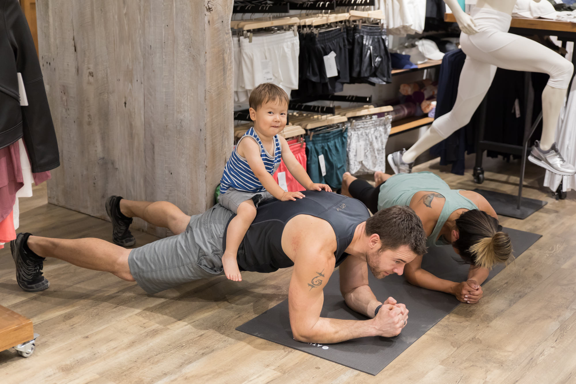 This little guy was a great sport, hanging out with his parents at the event while they worked out! I bet that plank is extra intense with the added weight!
