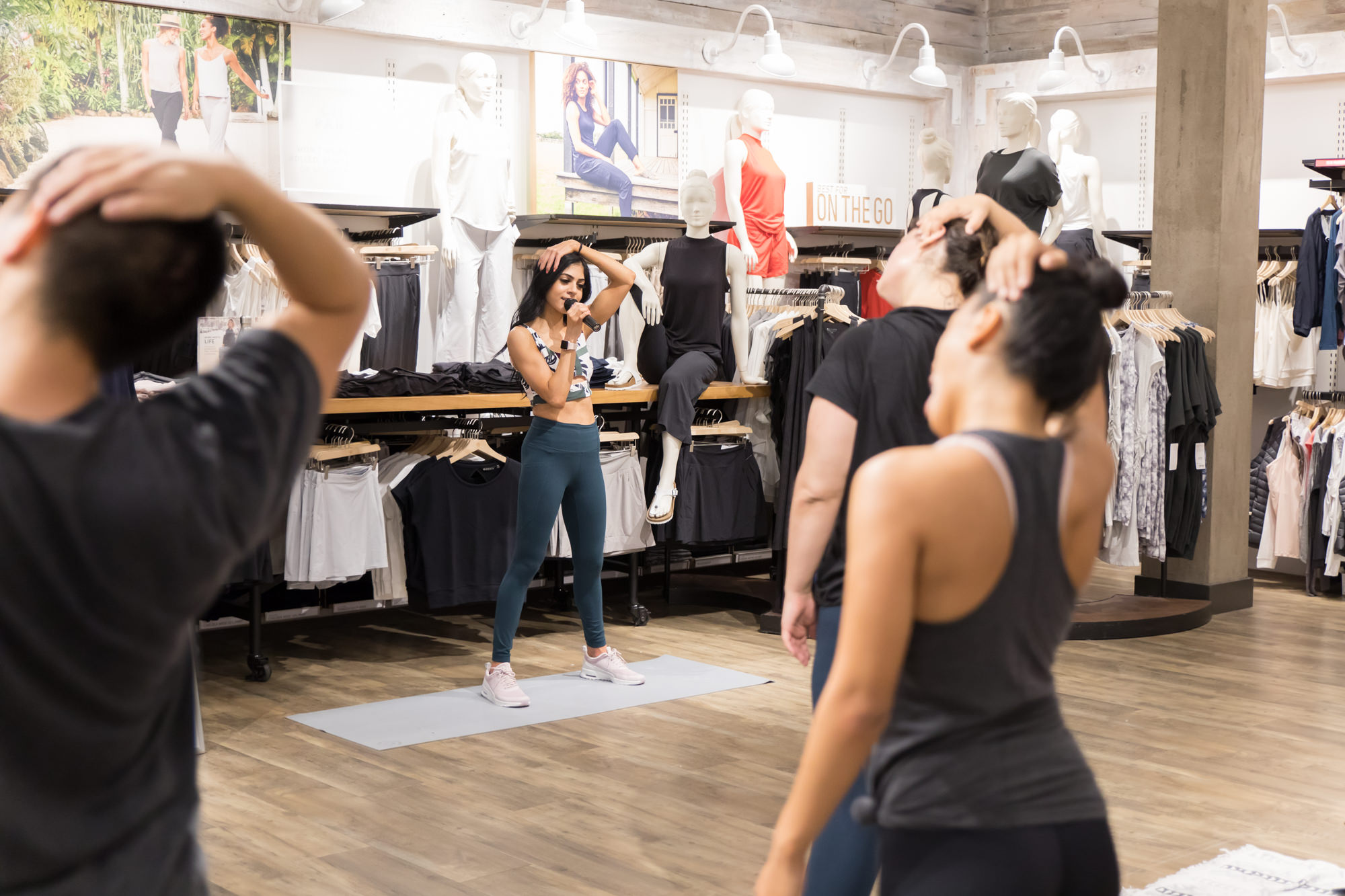 attendees-stretching-while-pegah-leads-group-fitness-pop-up-westfield-valley-fair-san-jose-in-athleta-store.jpg
