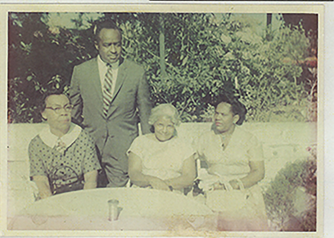 The only photo Avel Gorldy and Faye Marie Burch has with both grandmothers. Left-to-right: Grandmother Lessie Gordly, Uncle James Dowell; Mrs. Beatrice Gordly's brother (eldest); Grandmother Alberta Louise Randolph (3rd marriage); and James' wife Evelyn, Gordly-Burch Family Archive.
