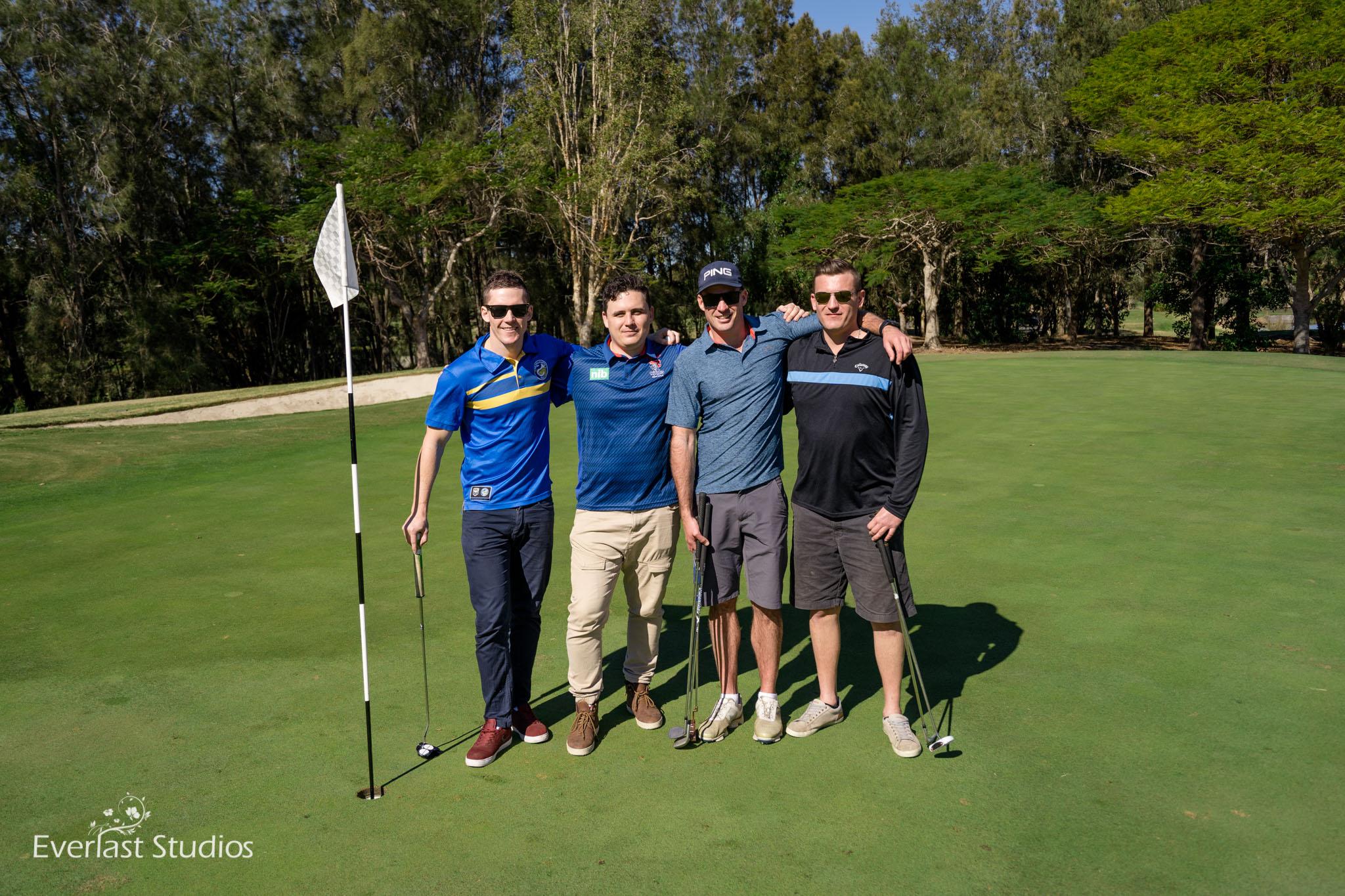 Groom and groomsmen play golf