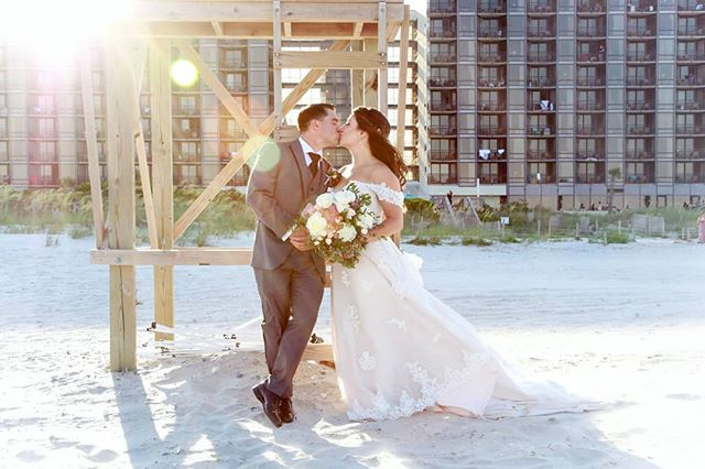 Last weekend at Shell Island Resort with this gorgeous couple 🌤🤵👰🏝 PS. I. Love. Sun. Flare. . . #brideandgroom #weddinginspo #bridestyle #weddingphotography  #wrightsvillebeach #wrightsvillebeachweddings #sunflare #weddingportrait #lifeguardstand #shellislandresort #atchuesyou #wilmingtonweddings