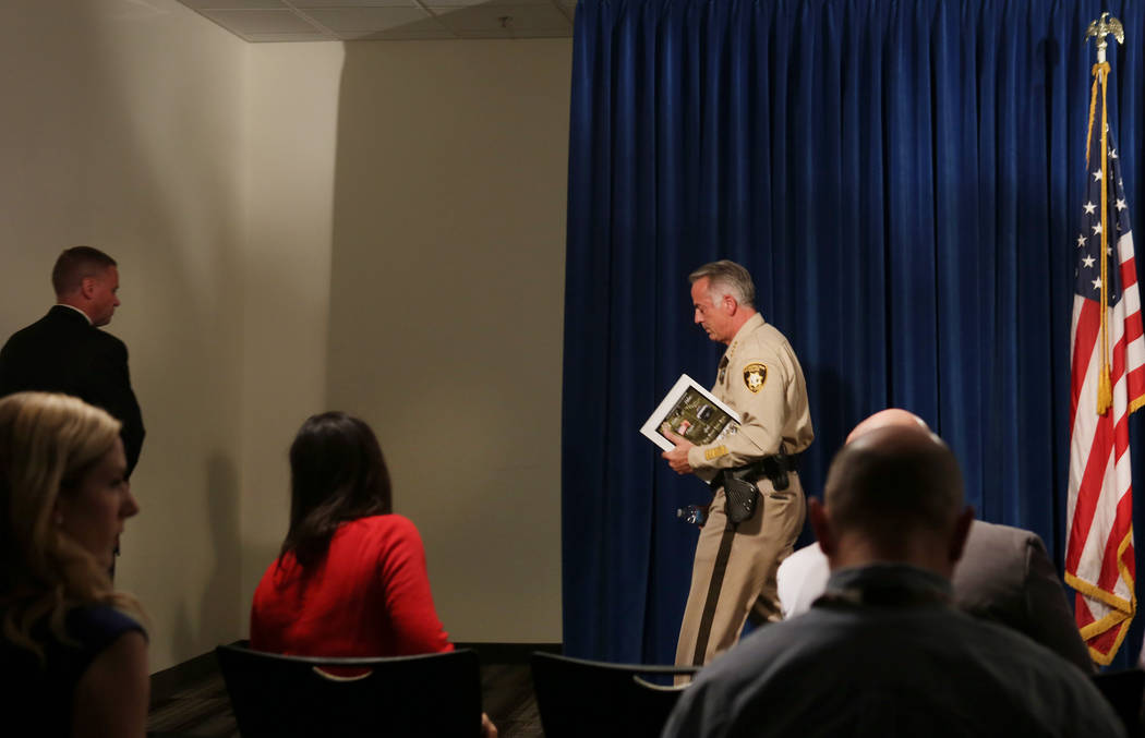 Clark County Sheriff Joe Lombardo leaves after announcing at the Las Vegas Police headquarters that officer Kenneth Lopera will be prosecuted for the in-custody death of Tashii Brown, Monday, June 5, 2017. [ MORE ] PSYCHE!