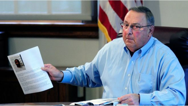 PROVOCATIVE RACIST Governor LePage held up mugshots he said showed that most men arrested in Maine on drug charges were black.