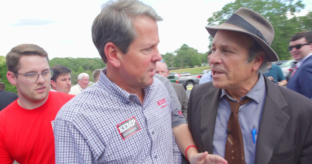 Elite Racists Have Abandoned Efforts to Propagandize 'the Appearance of Fairness in Elections' to Exclusively Promote the illusion of 'Participation in Democracy.'  Jim crow trickery is now just part of the deal, overwhelm the steal - fight harder for THE freedumb to choose your masters.  In photo. GREG PALAST ASKS RACIST BRIAN KEMP ABOUT HIS CONFLICT OF INTEREST IN COUNTING HIS OWN VOTES & PURGING HIS OPPONENT'S VOTES.