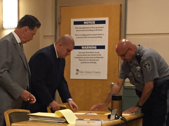 Jeffrey E. Proffit (center) is a suspended Millville police officer facing trial for allegedly abusing as many as 13 people. Proffit and attorney Michael L. Testa Sr. (left) were in Cumberland County Superior Court LAST YEAR.