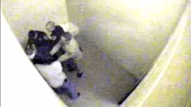 Video OF BRYANT with his pants down AND a spit mask on his head and he is surrounded by three WHITE officers that are about to do a probe, inside of a holding cell.
