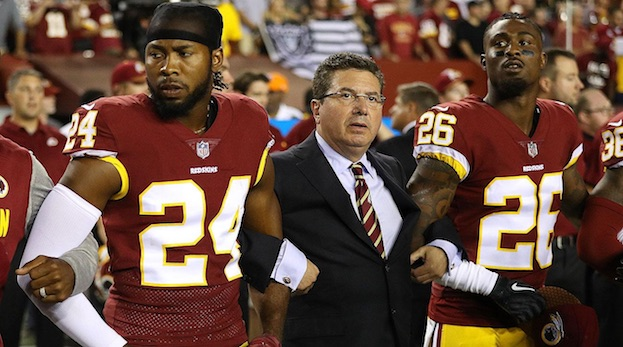 RACIST SUSPECT owner OF THE WASHINGTON NFL TEAM Daniel Snyder linked arms with HIS    NIGGER    cornerbacks Josh Norman (24) and Bashaud Breeland (26) during the national anthe before Snyder's team played the Oakland Raiders at FedEx Field on Sept 24, 2017.