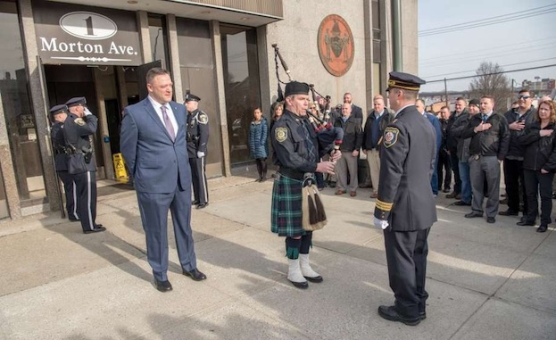 Albany Police Detective James Olsen stands outside South Station for a tradition piping out ceremony to mark his retirement on Jan. 4, 2018, in Albany, N.Y.