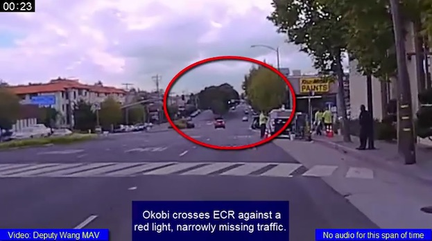 EVEN THE POLICE VIDEO CONTAINS NARRATIVE BASED ON LIES. HERE THE CAPTION SAYS HE NARROWLY MISSES ONCOMING TRAFFIC. YET HE IS NOT EVEN VISIBLE IN THE SHOT [see above]. He crosses after the car has passed him - he is one lane away. see pic below.
