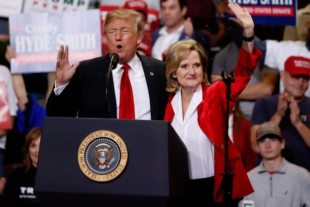 IN PHOTO    ELECTION CRIMINAL    TRUMP AND GOVERNOR HYDE SMITH.    FUNKTIONARY   EXPLAINS:   DUMBOCRACY - UNREPRESENTATIVE DEMOCRACY TOLERATED BY A PUBLIC SCHOOLED IN PUBLIC SCHOOLS.