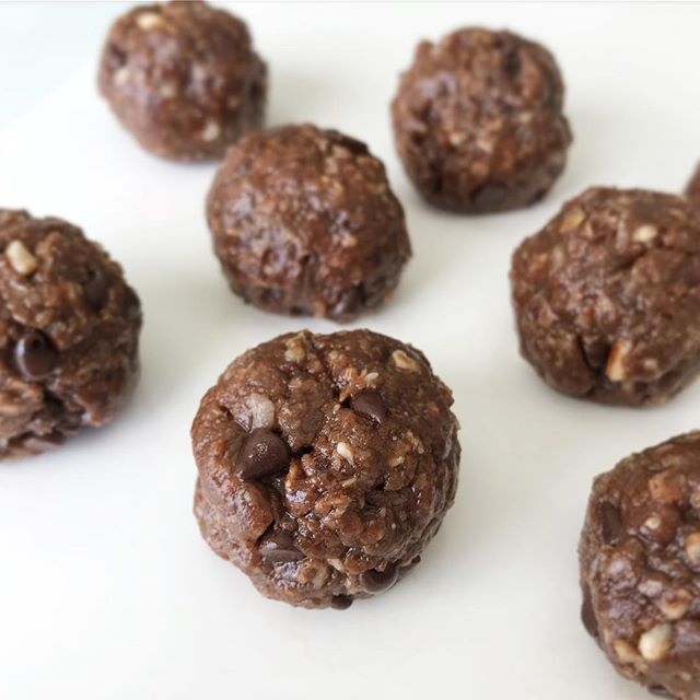 """I cant take any credit for these amazing power balls. I got the recipe from @cleaneats_cleantreats and they are my absolute favorite energy bites to make! I changed the recipe only according to what I used to make it gluten and dairy free.  Almond Joy Powerballs yield 30 balls Ingredients  1 1/2 cups @bobsredmill gluten free old fashion oats (slightly broken down in the blender) 1 cup almond butter ( I got mine at Costco)  1/2 cup toasted (don't skip that) unsweetened coconut 1/2 cup raw honey 1/4 cup @enjoylifefoods life chocolate chips 1 scoop @naturesproperty Chocolate Bone Broth Protien Powder  2 tbsp cocoa powder 2 tbsp chopped almonds 1-2 tbsp coconut milk (start with one, depending on the consistency you may not need to add the other) 1 tbsp coconut oil, melted 1 tsp almond extract 1/2 tsp vanilla extract 1/4 tsp sea salt Instructions  Combine all dry ingredients in kitchen-aid mixer bowl. Mix on low until ingredients are well blended. Add wet ingredients to blended dry ingredients. Mix on medium speed until a """"dough"""" forms. Scrape sides of bowl with a spatula and mix again if needed. Remove bowl from Kitchen-aid stand. Using a 2-inch cookie scoop form dough into balls. Set balls on a parchment lined cookie sheet or storage container and refrigerate for at least one hour or until ready to eat. Keep refrigerated up to one week, if they last that long! Enjoy!"""