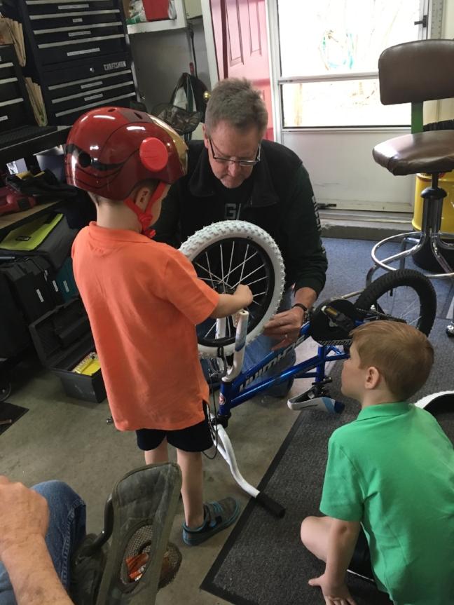 Helping Papa fix his bike.