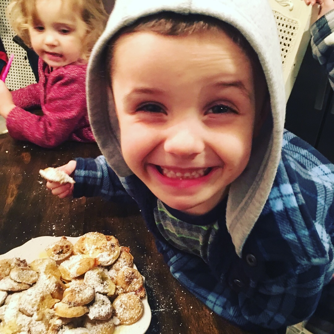 Eating poffertjes, one of his favorite things.